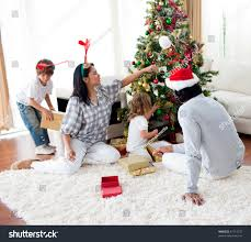 At Home Christmas Trees by Family Decorating Christmas Tree Home Stock Photo 41714737