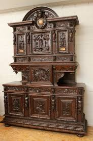 exceptional walnut renaissance figural cabinet with marble inlay
