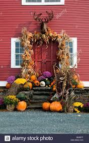 decorate house halloween farm house halloween display pumpkins squash corn husks