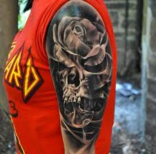 grey rose and skull tattoo on left half sleeve by damian gorski