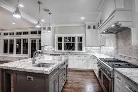 kitchen with granite counters and a white finish griffin custom