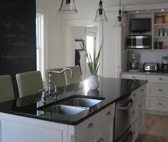white sink black countertop dual kitchen sink traditional kitchen benjamin moore white