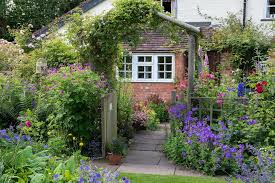 simple and easy low wooden cottage garden fencing planted with