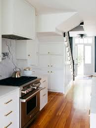 what floor goes best with white cabinets the 7 best white paint colors for kitchen cabinets