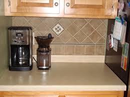 dark wood cabinets with black appliances front door tiles moen