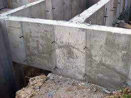 think of poured concrete walls as structural beams tribune