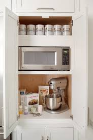 a bright small kitchen design with simple wooden kitchen island