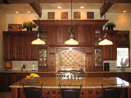 kitchen decor above cabinets decorating top of kitchen cabinets