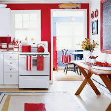 kitchen with red accessories and white range using red kitchen