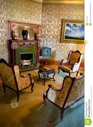 vintage retro victorian mansion parlor abd fireplace stock image