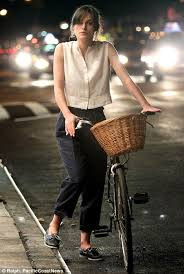keira knightley gets on her bike as she films can a song save your