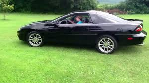 99 black camaro me driving a 1999 camaro z28 v8 engine chrome wheels flow master