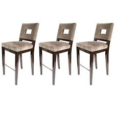 set of three mid century modern bar stools with cut out back