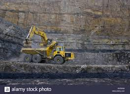 volvo heavy cat 375 excavator and volvo dumper truck heavy machinery working