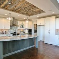 ceiling ideas for kitchen the use of distressed tin for the ceiling along with the wood