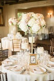 wedding center pieces polished navy gold and blush reception with settings with