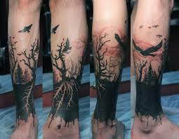 tree sillhouette tatto on back of leg tatto