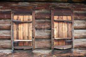 the rustic log wall and closed windows stock photo colourbox