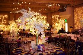 white gold and purple wedding gold purple white centerpieces indoor reception place settings