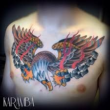 old style colored chest tattoo of eagle with broken chain