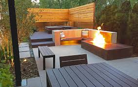 modern denver back yard with a fire pit outdoor kitchen privacy
