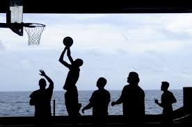 silhouette of men playing basketball free stock photo