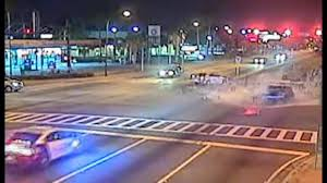 white lexus drag crash video shows cop speed through light crash into driver cnn video