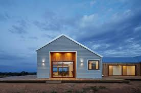 shed style architecture houzz tour a shed style home frames views and blends in