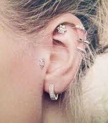 ear earings how to wear earrings at once whowhatwear