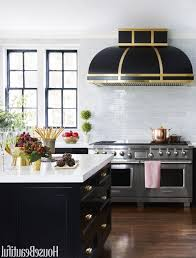 kitchen backsplash tile modern cooker hood above electric stove kitchen black marble countertop wood finished breakfast bar wall mount range hood lighting fixtures and bu