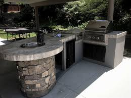 Custom Outdoor Kitchen With Rock Extreme Backyard Designs - Extreme backyard designs