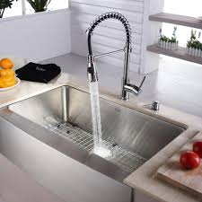 kitchen with apron sink decorating black granite countertop with graff faucets and