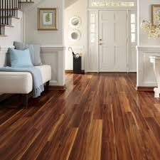 flooring home improvement project using dark wood laminate