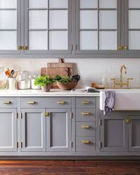 slate blue kitchen cabinets why you should incorporate brass into your kitchen asap