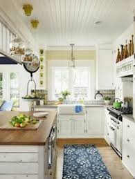 farmhouse kitchen ideas on a budget roses and rust brick floors kitchens
