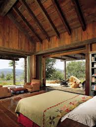 this beautifully rustic master bedroom has the best of views