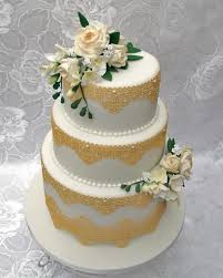 edible lace 3 tier wedding cake with gold edible lace and made sugar