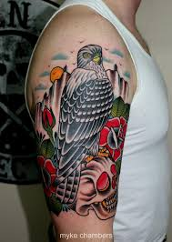 traditional eagle on skull with rose tattoo on right half sleeve