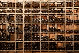 wine racks wall mural wine racks wallpaper wallsauce usa save your design for later