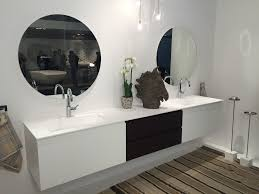 contemporary bathroom vanity in white with a small vase and