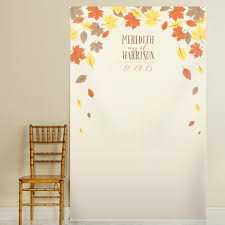 wedding backdrop name photo booth backdrop featuring falling leaves in brown orange
