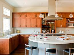 white wooden kitchen island and l shaped brown wooden kitchen