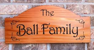 personalized redwood name plaque with engraved lettering