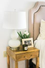 neutral bedroom with plants the mama notes