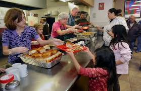 blessings and giving thanks at the soup kitchen local