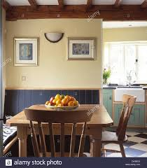 bowl of fruit on pine table with pine chairs in cottage dining bowl of fruit on pine table with pine chairs in cottage dining room with tongue