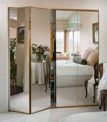 hang mirrors on your bifold closet doors hanging mirrors