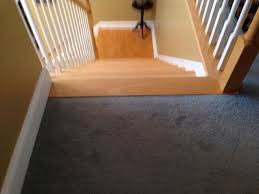 laminate floor on landing at top of stairs transition