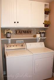 best 20 laundry room storage ideas on pinterest utility room storage over the washer and dryer in laundry room
