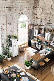 modern living room and kitchen combo with industrial touches industrial kitchen industrial style loft kitchen with decorative plants metal cabinet butcher block couuntertop cube